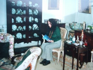 """Olivia in her drawing room. Click to see more clearly. I cannot give photo credit. She sent me this snapshot about six years ago, with a note in its back, """"The drawing room, remember?,"""" which was her usual very sweet self."""