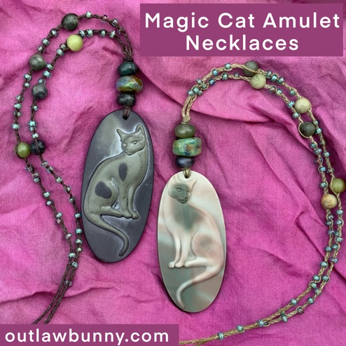 Two magic cat amulet necklaces
