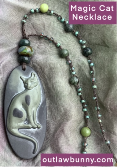 a magic cat amulet necklace
